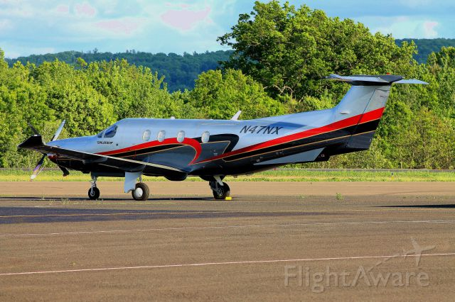 Pilatus PC-12 (N47NX) - Pilatus N47NX parked outside its hangar on a chilly spring evening, prepared for its morning flight to California the next day. Photo taken on May 26, 2013.