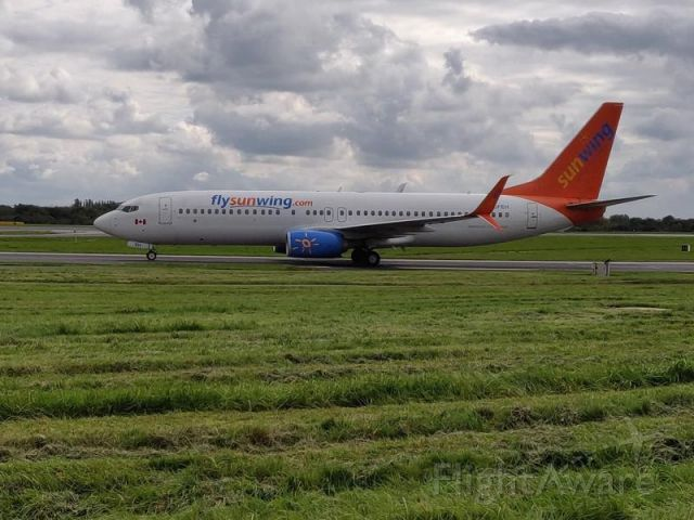 Boeing 737-800 (C-GFEH) - TAXING AFTER LANDING AT MANCHESTER