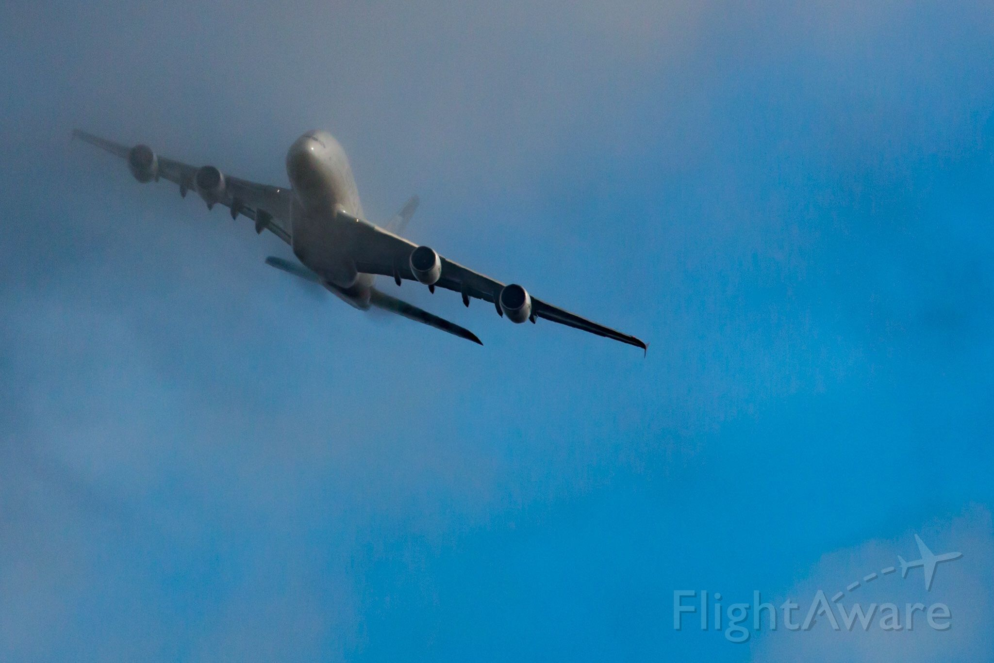 Airbus A380-800 (A6-APB) - Coming through low cloud cover, Turning to align to JFK 22R, over Long Island, new A380 service