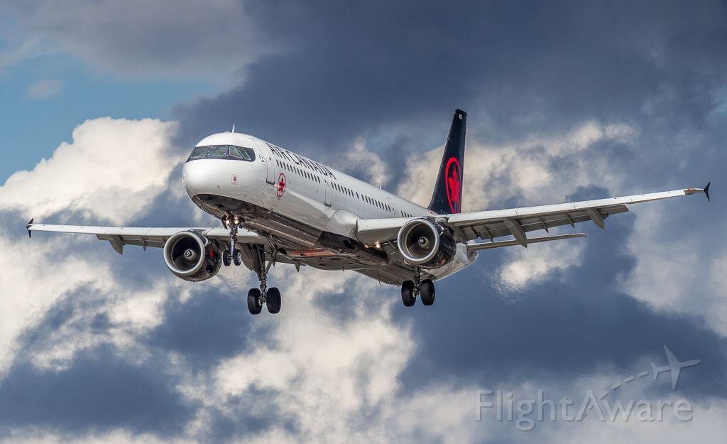 Airbus A321 (C-GIUF) - This AC A321 returns home through a turbulent sky...