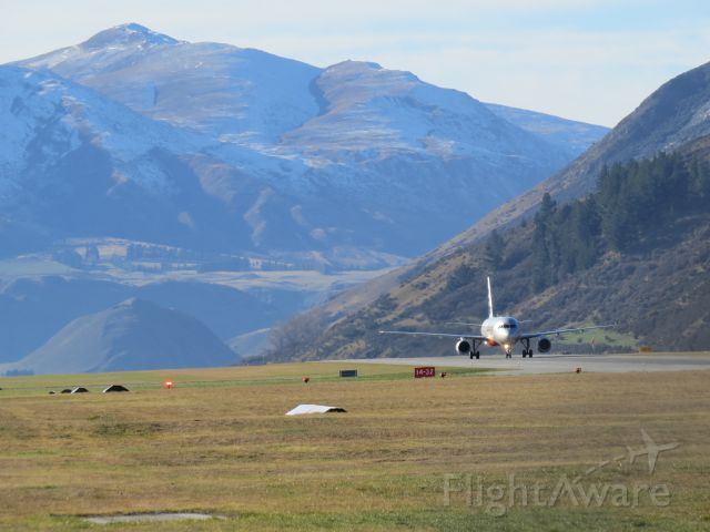 Airbus A320 (VH-VGY) - VH-VGY taxiing at NZQN after arriving from NZAA on a beautiful winters day  in Queenstown.