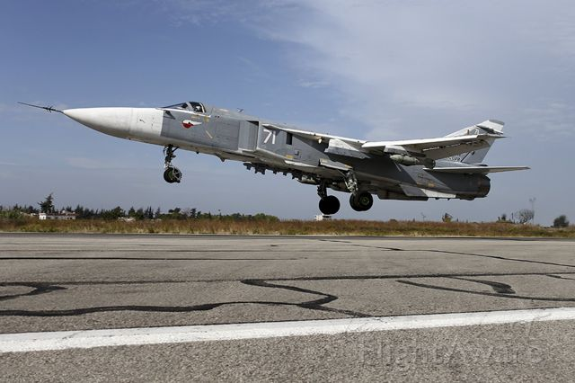 — — - A Sukhoi Su-24 fighter jet takes off from the Hmeymim air base near Latakia, Syria, in this handout photograph released by Russia