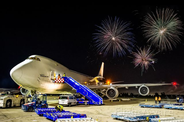 BOEING 747-8 (N859GT) - New Years In Chile | Chilebr /br /The rampers watch as New Years gets rung in with a bang. Atlas Airs newest addition sits on the ramp awaiting the rampers to finish before blasting off for Miami. br /br /©Bo Ryan Photography | a rel=nofollow href=http://www.facebook.com/boryanphotowww.facebook.com/boryanphoto/a