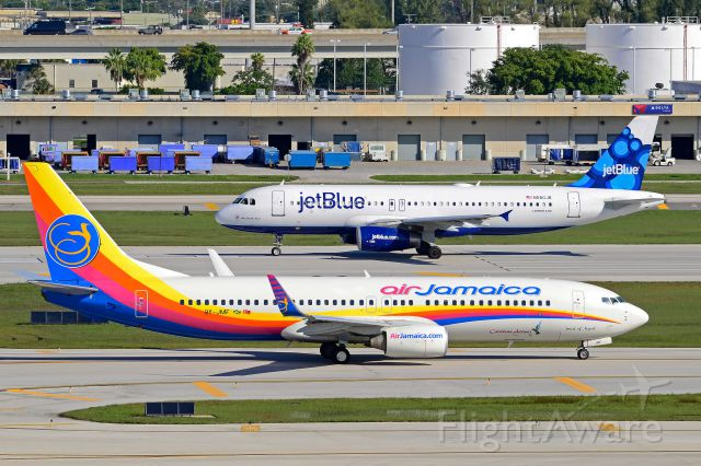 Boeing 737-800 (9Y-JMF) - Caribbean Airlines - 9Y-JMF Taxiing for departure out of Fort Lauderdale International Airport, RWY 27R. Courtesy JT Occhialini ©