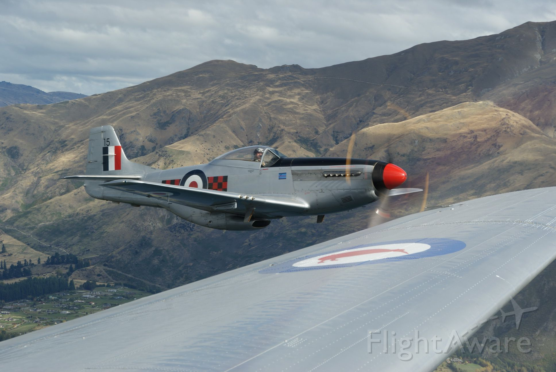 North American P-51 Mustang (ANZ2415) - Formation flypast of 2 X DC-3's escorted by 2 X P51's and 2 X Spitfires at Warbirds Over Wanaka airshow.