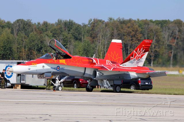 McDonnell Douglas FA-18 Hornet (18-8734) - A sharp looking Royal Canadian Air Force (RCAF) custom-painted red and white CF-18 (188734, c/n 249) from 4 Wing, CFB Cold Lake, just before Friday afternoon practice on 22 Sept 2017. Canadian Forces Base Cold Lake (CYOD) is located in Alberta, CA. Photo taken at AirShow London 2017, London International Airport, Ontario, CA (CYXU) on 22 Sept 2017.
