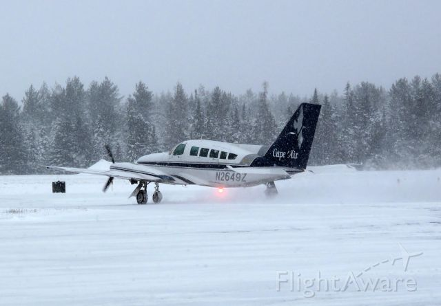 Cessna 402 (N2649Z) - Taxi out for departure. Long delays to be expected. Hard working pilots in a challenging weather environment, summer and winter.