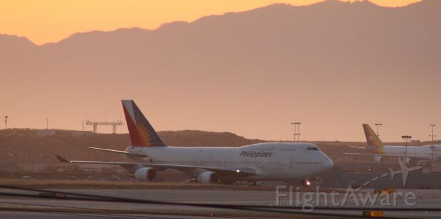 Boeing 747-400 — - Philippine 747-400 taxiing at sunset.