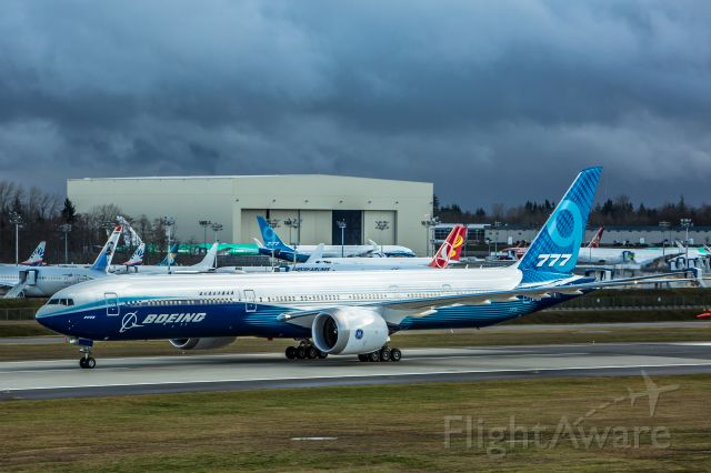 BOEING 777-9 (N779XW) - After three and a half hours of weather delays Boeing scrubbed the first flight of the 777X (777-9). Here the Dash 9 taxis back to the lineup at 2:34 PM 1-24-2020