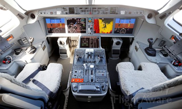 — — - The cockpit of a Bombardier C-Series aircraft.