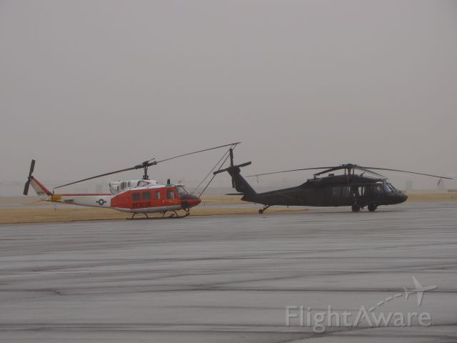 — — - Huey and Blackhawk sitting next to each other Navy and Army. Unusual to see these next to each other, rare.