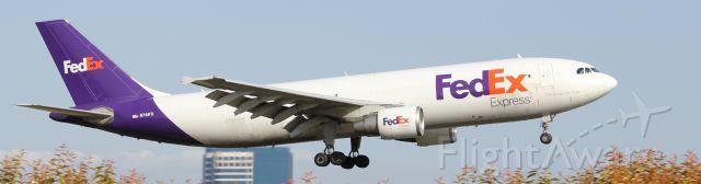 Airbus A300F4-600 (N741FD) - A FedEx A300 lands at KSNA after a long flight from Memphis Intl.