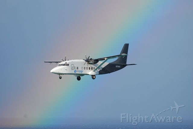 Short SD3-60 (N376AC) - From balcony at Maho Beach in St. Maarten. A beautiful rainbow after a storm.