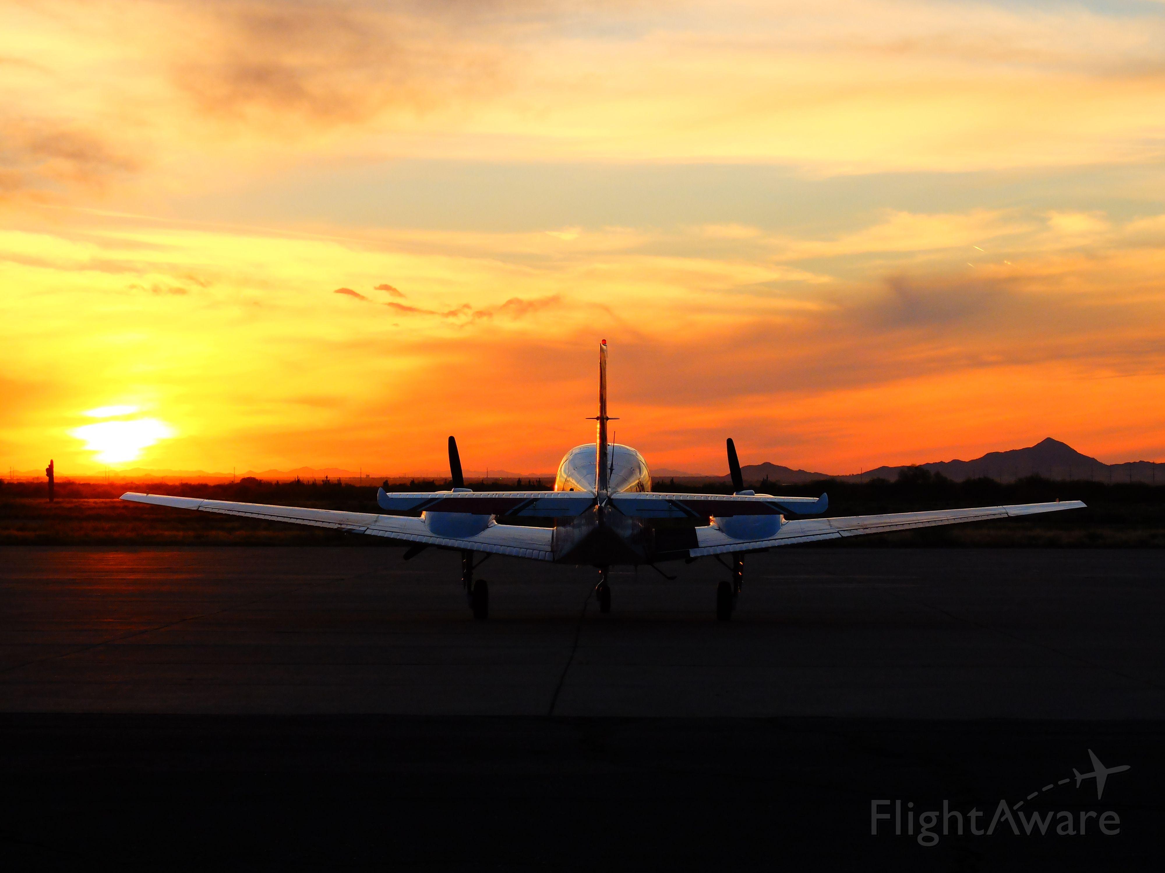 Beechcraft 55 Baron (N177AB) - N177AB at P08 sunset