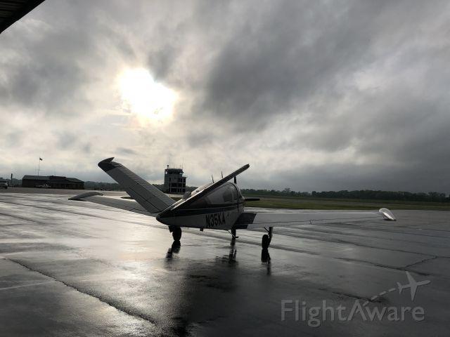Beechcraft 35 Bonanza (N35KA) - Rainy departure from Millington, TN