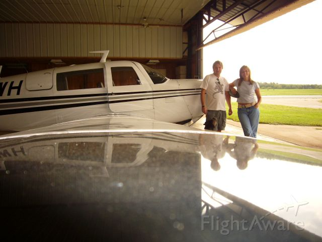 Mooney M-20 (N201WH) - Joe and Cathy (Coney lower) with 201WH