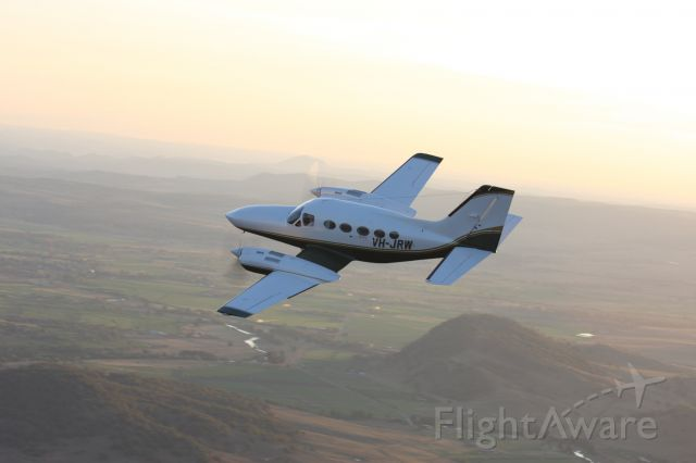 Cessna 421 (VH-JRW) - Airspeed Aviation's C421 Golden Eagle over the Segenhoe Valley near Scone, NSW.