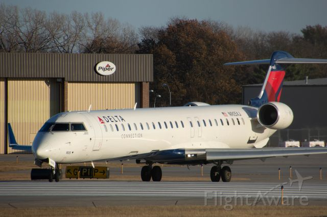 Canadair Regional Jet CRJ-900 (N905XJ) - Delta Connection CR9 is turning crossing the threshold of Runway 23 for departure out to MSP. Photo taken November 23, 2019 with Nikon D3200 at 400mm.