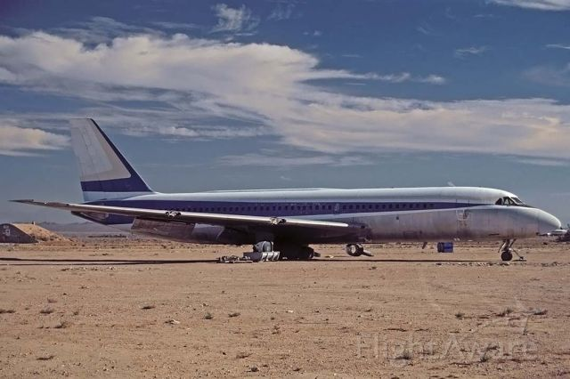 N812AJ — - Convair Cv-880 N812AJ at the Mojave Airport on September 10, 2001. Its Convair construction number is 22-00-23. It was delivered to TWA as N817TW in 1960 and immediately leased to Northeast Airlines. Warner Brothers bought it in 1990. Its left wing tip was removed during filming of a runway collision for the movie The Rookie, which featured Clint Eastwood and Charlie Sheen.