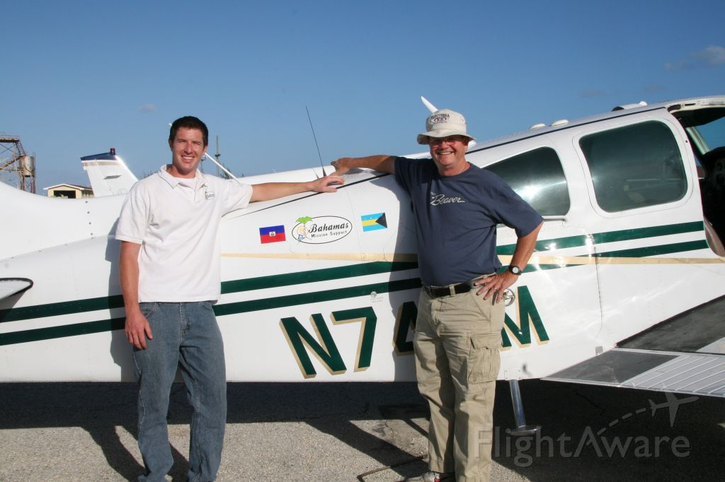 Beechcraft 55 Baron (N74EM) - Steve Merritt and Abraham McIntyre at Governors Harbor, Eleuthera.