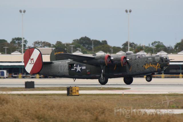 """Consolidated B-24 Liberator (N224J) - B-24 Liberator """"Witchcraft"""" departs Sarasota-Bradenton International Airport enroute to Punta Gorda Airport"""