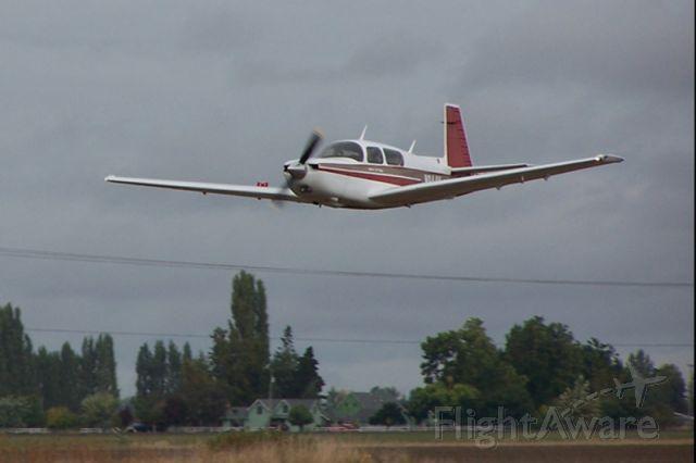 Mooney M-20 Turbo (N944Y) - Photo by Monica Kraus.  Pilot, Jon Yoder