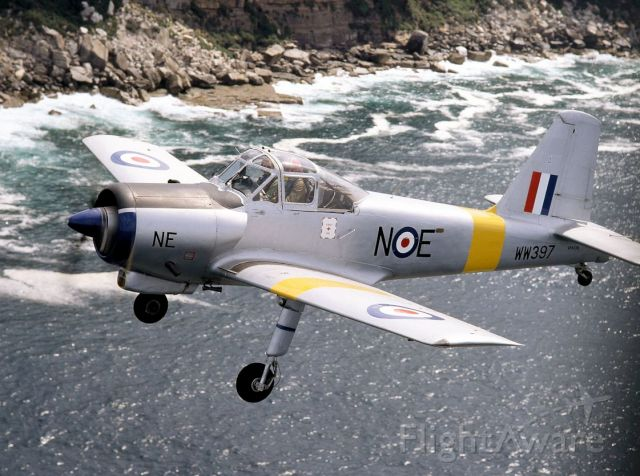 VH-OIL — - Beautiful coastal scenery behind restored Provost WW397 in air to air by Bob Livingstone 26 September 1994