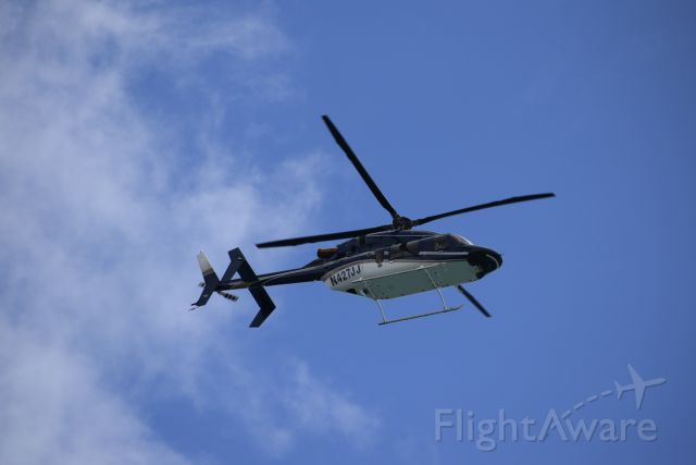 Bell 427 (N427JJ) - A windy day at the beach brings a great view of a 427 ..