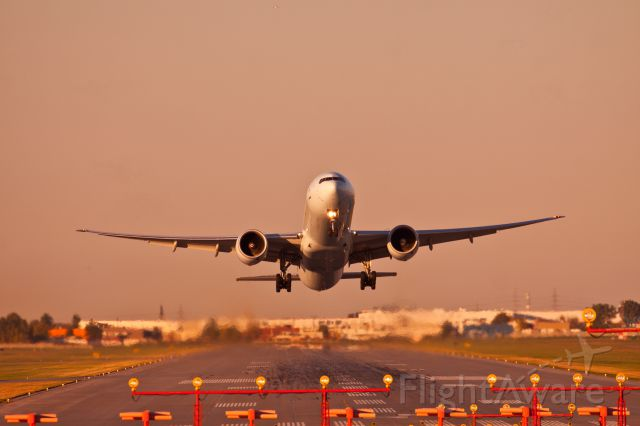 Boeing 777 — - Heavy departure in Montreal! This is one of the best shots Ive ever taken, back in 2013.