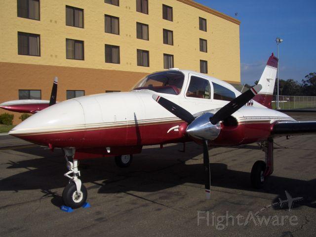 Cessna 310 (N310RR) - At Santa Maria Airport (KSMX).  Outside of the Raddison.