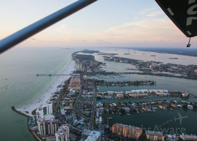 """N77EV — - Looking north at Clearwater Beach at sunset. The weather was warm and pleasant, the view extraordinary. The plane flew great. You should have been here! This vacation moment was taken May 29, 2016 at about 20:15. Clearwater Beach is one of the most highly rated vacation destinations in the United States. It is a fantastic place. Thanks to Dane Hauser ay Sky-Surfing.com for the ride! The Revo handled great and dispensed with my previous """"hang glider"""" misconceptions, that baby could really fly!"""