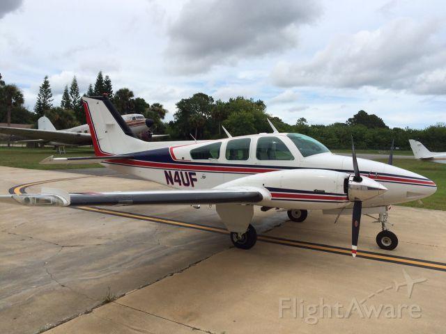 Beechcraft 55 Baron (N4UF) - At George Baker Aviation, New Symrna Beach, Florida