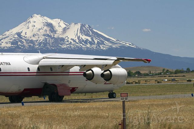 British Aerospace BAe-146-200 (N471NA) - Taxiing for take-off after being loaded with retardant.  Mt. Shasta in the background.