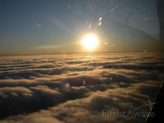 Cessna 177RG Cardinal RG (N45086) - Flying above the clouds before sunset.