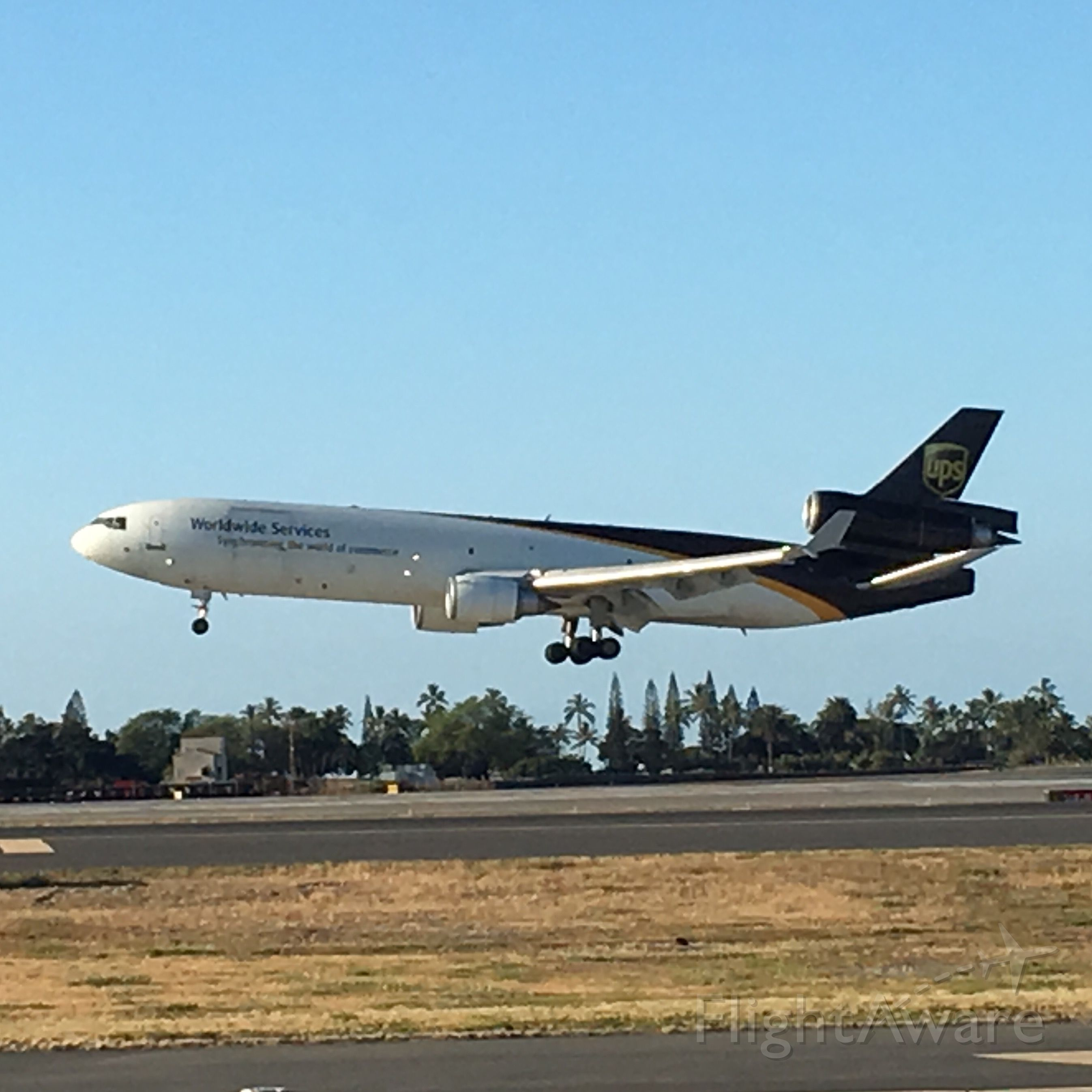 Boeing MD-11 — - A UPS MD-11 arrives at Honolulu International Airport