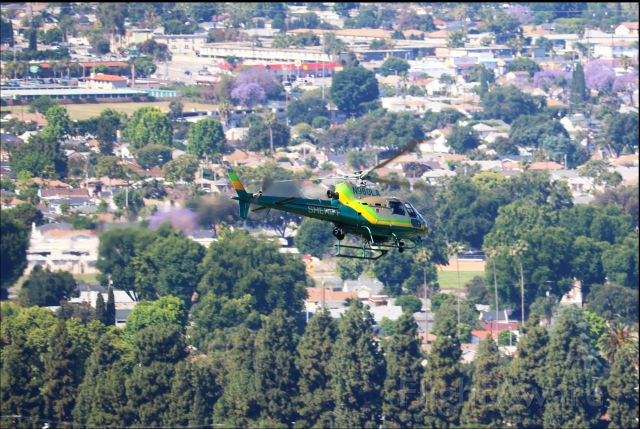 Eurocopter AS-350 AStar (N960LA) - Los Angeles County owned helicopter actively assisting a law enforcement action. Photo shot from my house.