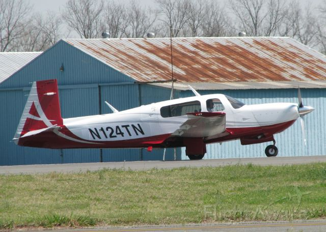 Mooney M-20 (N124TN) - Starting to roll down runway 14 at the Shreveport Downtown airport.