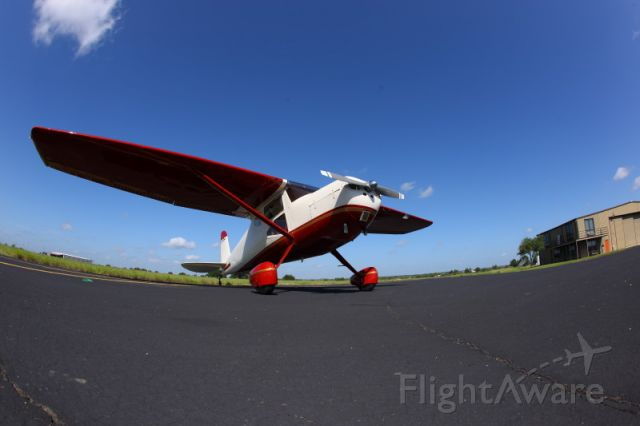 Cessna 140 (N140LA) - On the ramp at Breckenridge, Texas in front of HP hangar..