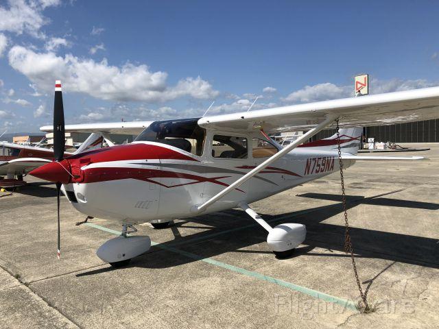 Cessna Skylane (N759NA) - Sunny day on the ramp at Hollister, CA (KCVH)