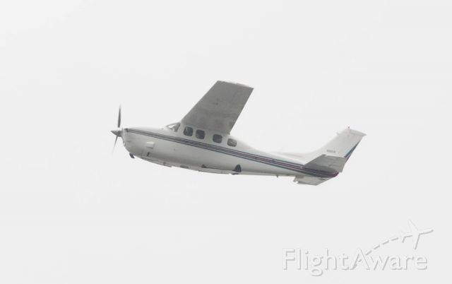 Cessna P210 Pressurized Centurion (N92CK) - Climbing out after departure on a cloudy day