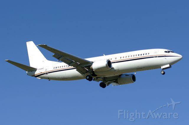 BOEING 737-400 (N129AC) - 12R approach