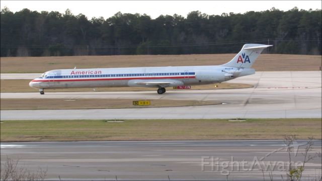 McDonnell Douglas MD-83 (N972TW) - An American Airlines McDonnell Douglas MD-80 landing at Raleigh-Durham Intl. Airport. This was taken from the observation deck on January 17, 2016 at 4:40 PM. This is flight 1348 from DFW.