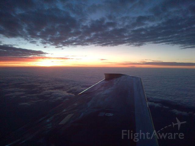 Mooney M-20 Turbo (N411JL) - Sunrise between layers at FL180
