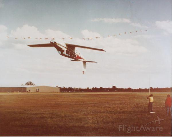 Beechcraft Bonanza (33) (N455DC) - Marion Cole performing ribbon cut 1978 Oshkosh, WI