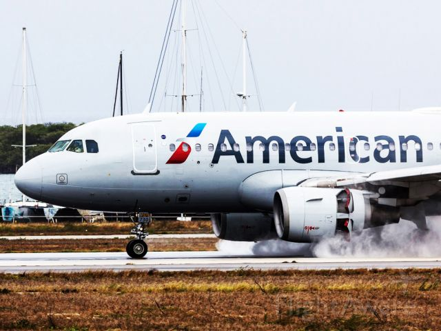 Airbus A319 (N730US) - Runway dryer.