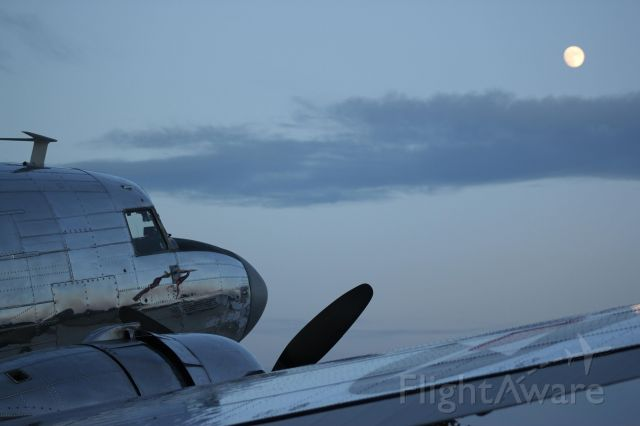 — — - C47 parked at Stearman Field on the Friday Night DC3 fly-in.  The airplanes were headed to OSH.