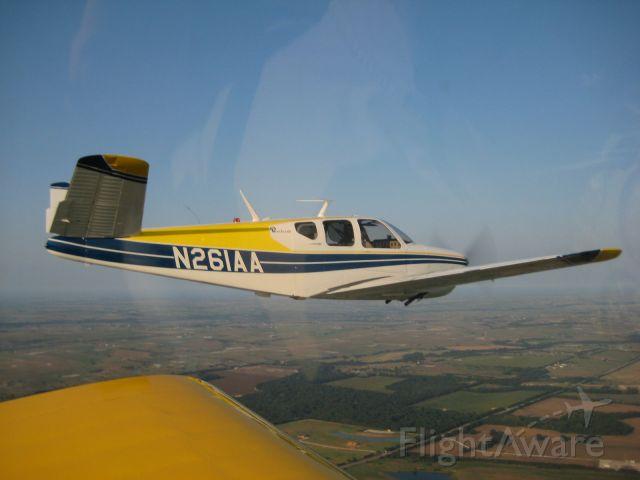 Beechcraft 35 Bonanza (N261AA) - Early morning flight.