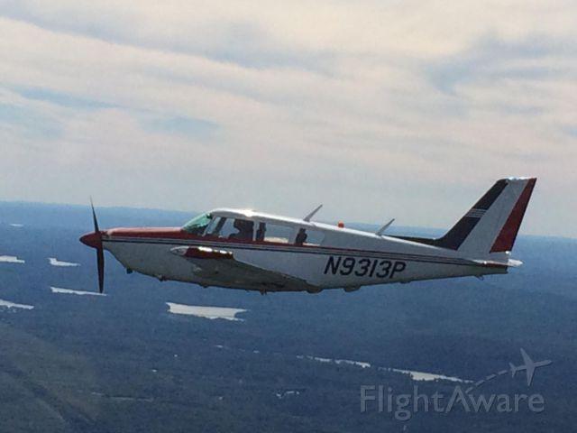 Piper PA-24 Comanche (N9313P) - Over Conn