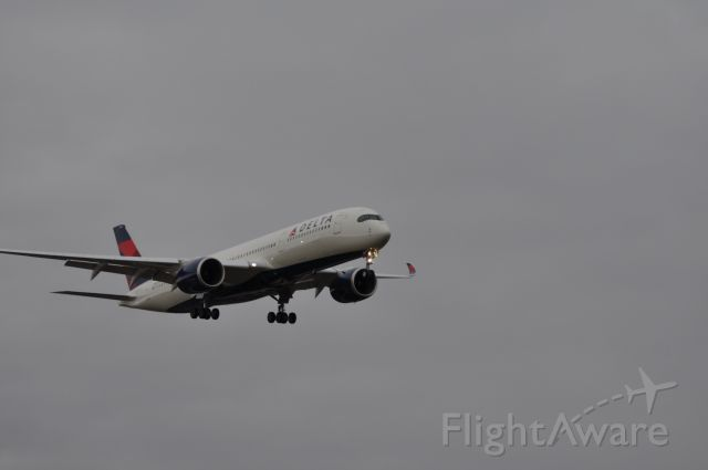 Airbus A350-900 (N502DN) - On short final in stormy weather after an 11 hour flight in to DTW from NRT