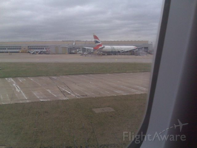 Boeing 777-200 (G-YMMM) - Photo of BA38 wreck at Heathrow viewed from 12A on VS11/22FEB during taxi for takeoff on 27L.